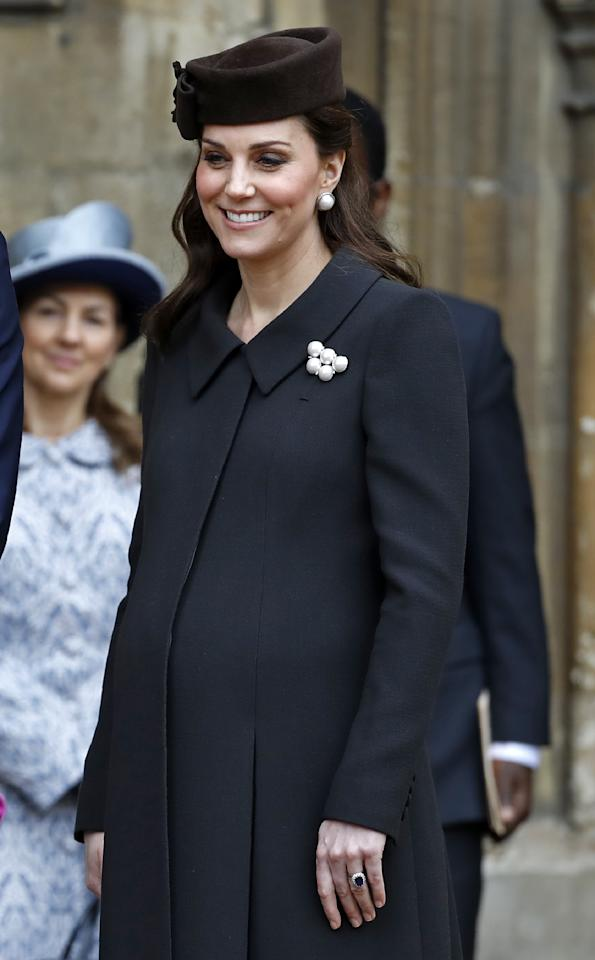 <p><strong>The occassion:</strong> The Easter Sunday church service at St George's Chapel, Windsor Castle.<br /><strong>The look: </strong>A black coat with a brown hat and pearl-adorned brooch. <br />[Photo: Getty] </p>