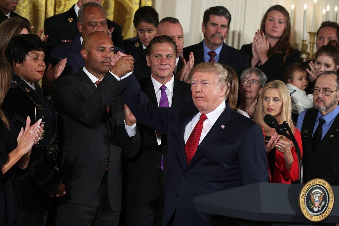 """<div class=""""inline-image__caption""""> <p>President Donald Trump holds hands with Mariano Rivera during an event highlighting the opioid crisis in the U.S. on October 26, 2017, in the East Room of the White House in Washington, D.C. </p> </div> <div class=""""inline-image__credit""""> Alex Wong/Getty </div>"""