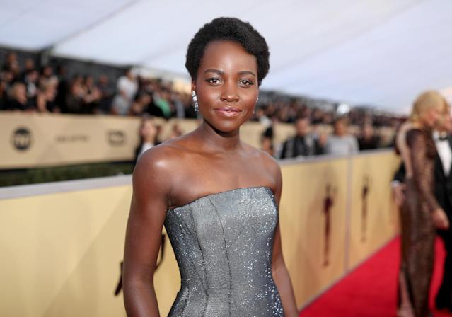 <p>Vernon François is one of Lupita's go-to stylists, and he certainly didn't disappoint by adding beautiful shape to Lupita's close-cut Afro. To re-create Lupita's look, he prepperd her hair with Vernon François Leave-In Conditioner and finished by contouring and sculpting her hair into a side quiff using U-pins to secure. (Photo: Getty Images) </p>