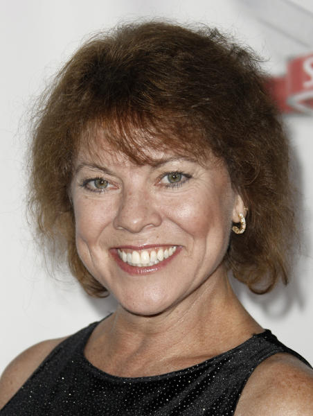 "FILE - In this Sept. 24, 2008 file photo, Erin Moran arrives at the Fox Reality Channel Really Awards in Los Angeles. Moran, the former child star who played Joanie Cunningham in the sitcoms ""Happy Days"" and ""Joanie Loves Chachi,"" has died at age 56. Police in Harrison County, Indiana said that she had been found unresponsive Saturday, April 22, 2017, after authorities received a 911 call. (AP Photo/Matt Sayles, File)"