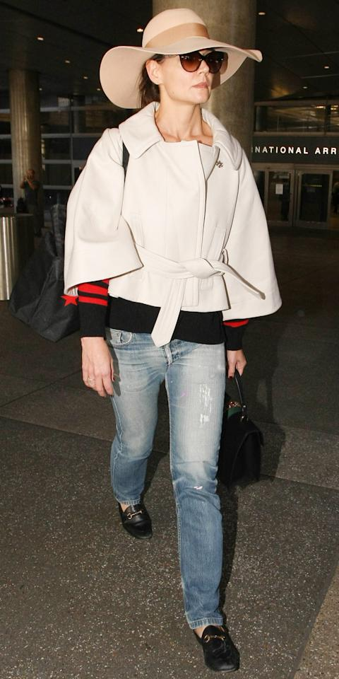 "<p>Holmes was barely recognizable at the airport in a floppy tan hat and sunglasses, but her chic street style set her apart from the crowd. Dressed in a cropped beige jacket, distressed jeans, and classic Gucci loafers ($630; <a rel=""nofollow"" href=""https://click.linksynergy.com/fs-bin/click?id=93xLBvPhAeE&subid=0&offerid=390098.1&type=10&tmpid=8156&RD_PARM1=http%253A%252F%252Fshop.nordstrom.com%252Fs%252Fgucci-brixton-loafer-women%252F4178560%253Fcm_mmc%253DLinkshare-_-partner-_-10-_-1%2526siteId%253DJ84DHJLQkR4-vSWNJbo_h6jdehcQqFhE5w&u1=ISKatieHolmesSSGucciLoaferIJMarch"">shop.nordstrom.com</a>), the actress proved her sartorial know-how. </p>"