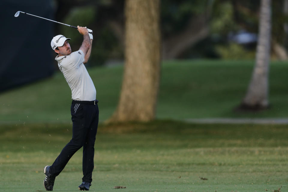 Nick Taylor hits from the eighth fairway during the second round of the Sony Open golf tournament Friday, Jan. 15, 2021, at Waialae Country Club in Honolulu. (AP Photo/Jamm Aquino)