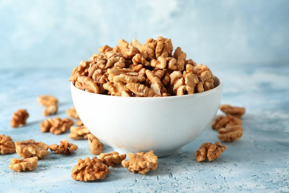 "<p>Walnuts are a nutrient-dense food you can add to oatmeal, trail mix, and yogurt. When managing PCOS, walnuts are a great choice because they contain a balance of healthy fats, plant-based proteins, and fiber, which may help manage your blood sugar. In one study, people with PCOS who ate walnuts for six weeks <a href=""https://pubmed.ncbi.nlm.nih.gov/21157477/"" class=""link rapid-noclick-resp"" rel=""nofollow noopener"" target=""_blank"" data-ylk=""slk:experienced lower levels of &quot;bad&quot; cholesterol and improved insulin sensitivity"">experienced lower levels of ""bad"" cholesterol and improved insulin sensitivity</a>.</p>"