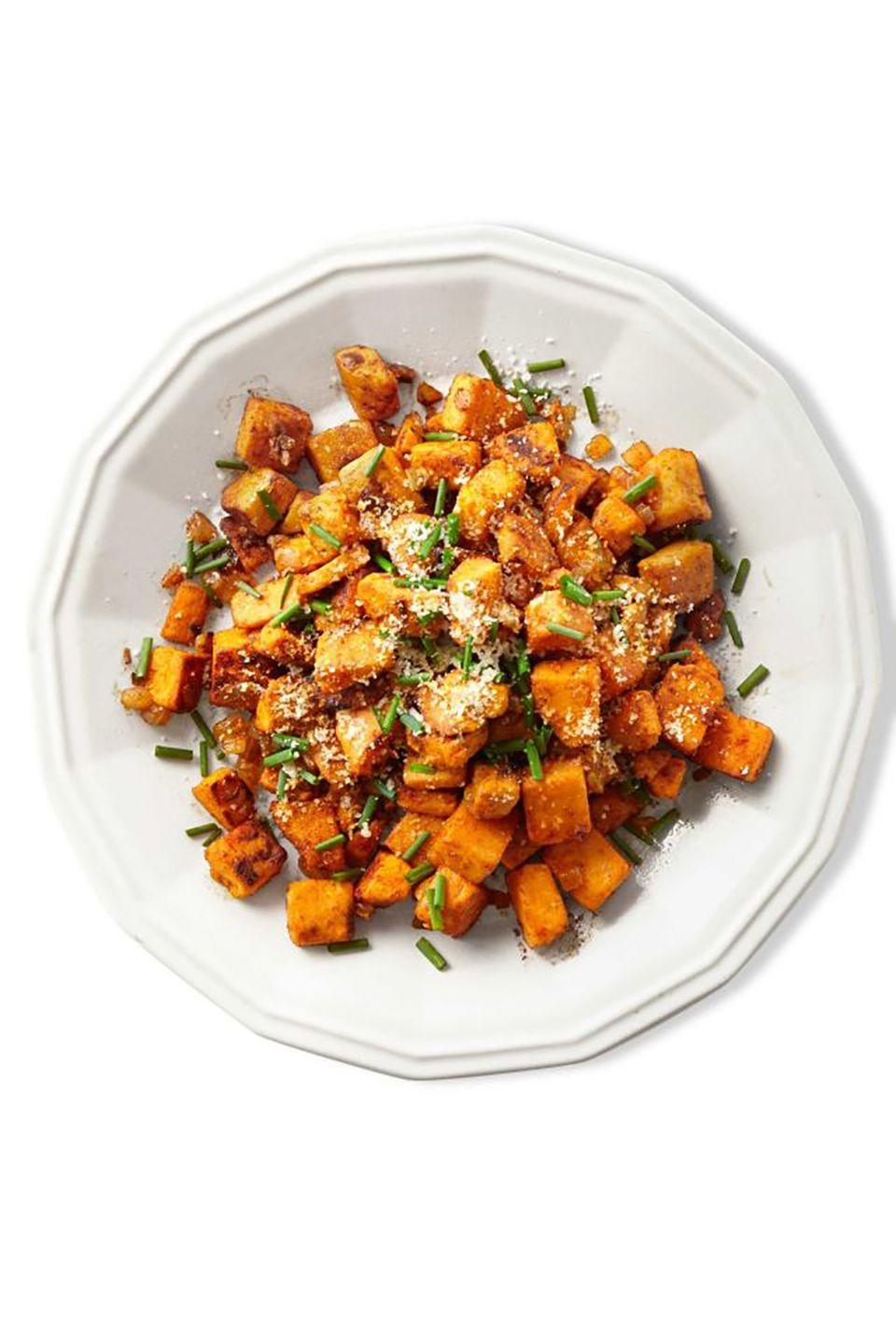 """<p>Serve up these savory smoky hash as a side for breakfast, lunch, <em>or </em>dinner.</p><p><strong><a href=""""https://www.countryliving.com/food-drinks/recipes/a39376/sweet-potato-hash-recipe/"""" rel=""""nofollow noopener"""" target=""""_blank"""" data-ylk=""""slk:Get the recipe"""" class=""""link rapid-noclick-resp"""">Get the recipe</a>.</strong><br></p><p><a class=""""link rapid-noclick-resp"""" href=""""https://www.amazon.com/T-fal-Specialty-Nonstick-Dishwasher-Cookware/dp/B000EM9PTQ?tag=syn-yahoo-20&ascsubtag=%5Bartid%7C10050.g.877%5Bsrc%7Cyahoo-us"""" rel=""""nofollow noopener"""" target=""""_blank"""" data-ylk=""""slk:SHOP SKILLETS"""">SHOP SKILLETS</a></p>"""