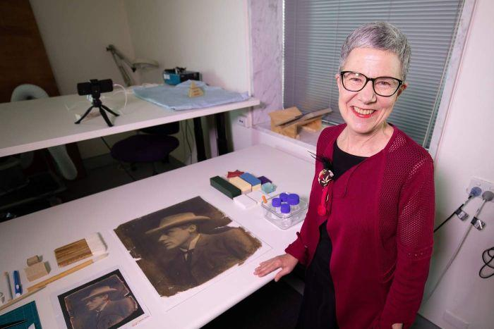 Marie-Louise Ayres with a restored photograph.