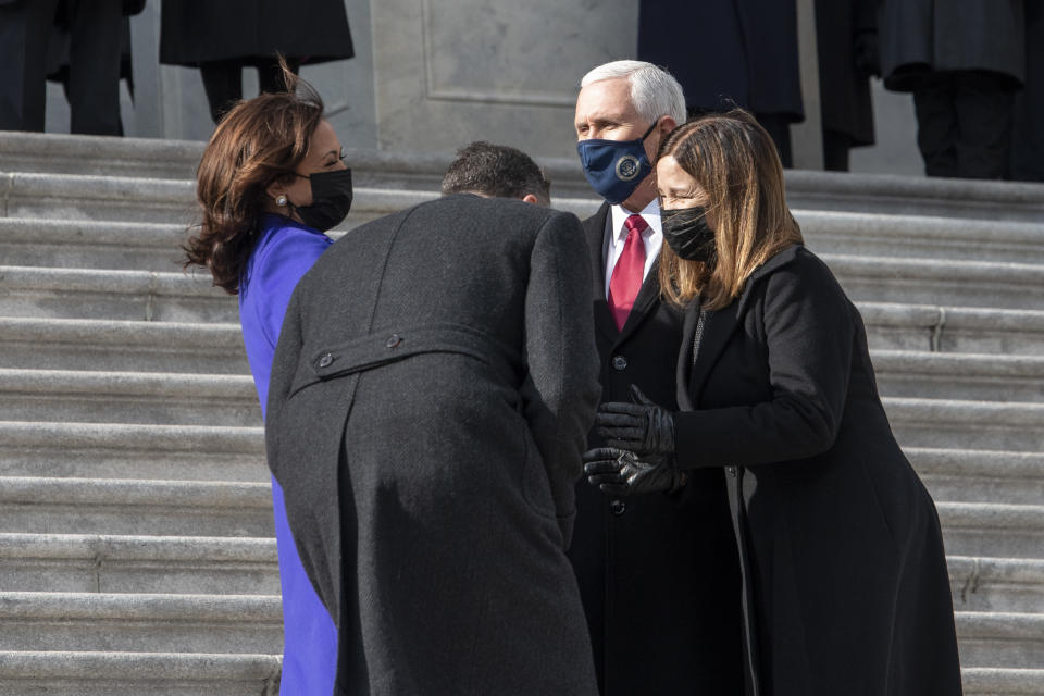 Vice President Kamala Harris and her husband Doug Emhoff, chat with former Vice President Mike Pence and his wife Karen as they walk down the Capitol steps following the inauguration of President Joe Biden, Wednesday, Jan. 20, 2021, at the U.S. Capitol in Washington. (Rod Lamkey/Pool Photo via AP)
