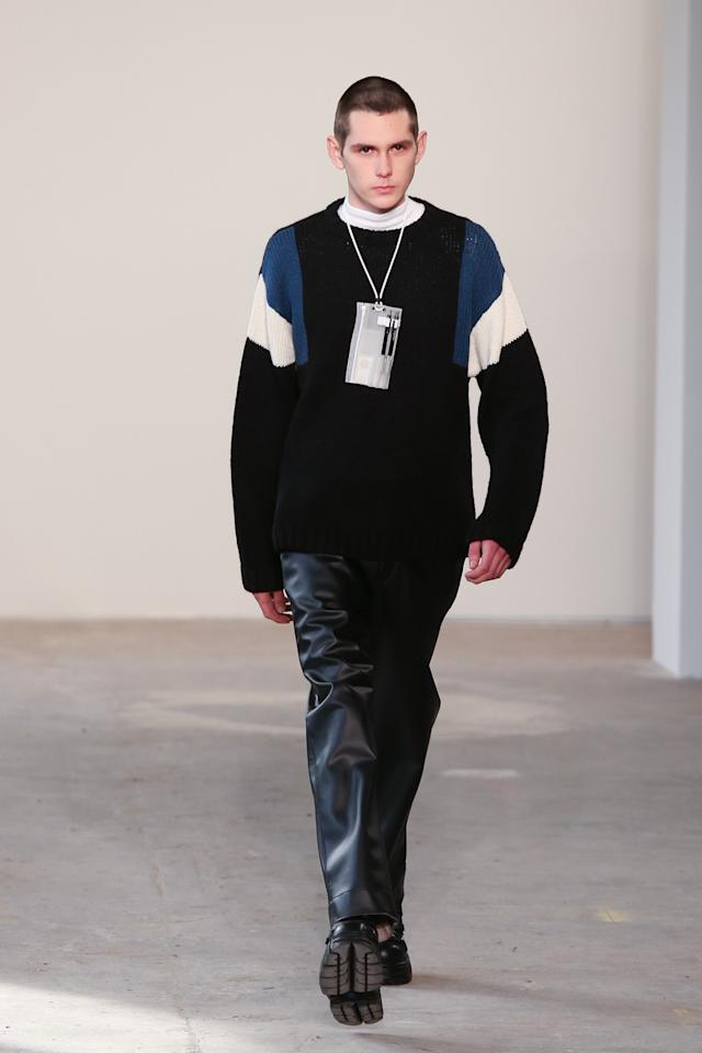 <p>Introducing the PVC Liquid Vinyl Office Lanyard giving new life to formerly bleak office apparel. Seen here paired with a ribbed royal blue and white sweater and navy utility pants. <i>(Photo: Getty)</i> </p>
