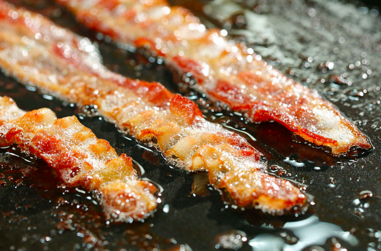 Health questions: Eating processed food like bacon regularly could provoke an asthma attack (Getty)