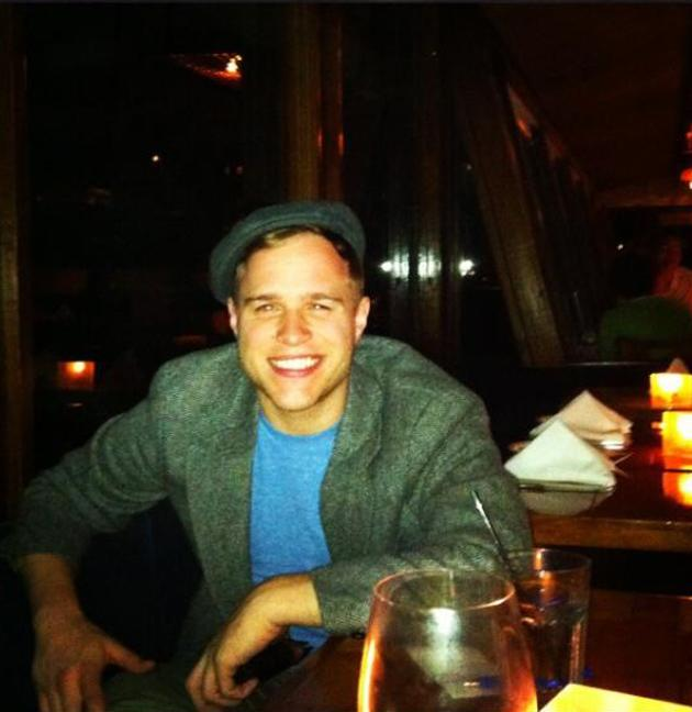"Celebrity photos: Olly Murs has been hanging out in America, writing for his new album before heading on tour with One Direction. He tweeted this picture of him enjoying some downtime at a restaurant, along with the caption: ""Chilling in Malibu!! It's lush here just had a gorge fish meal!!!"" [sic]"