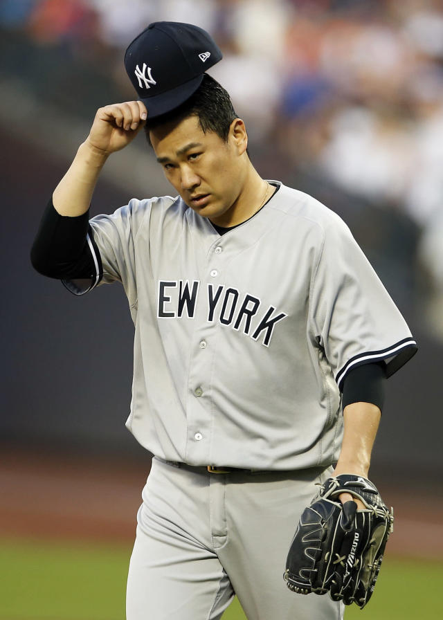 New York Yankees pitcher Masahiro Tanaka reacts during the third inning of a baseball game against the New York Mets, Friday, June 8, 2018, in New York. (AP Photo/Adam Hunger)
