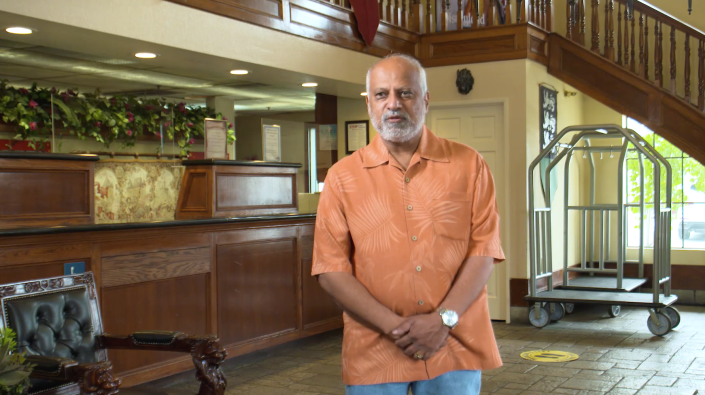 Bharat Patel discusses his empty hotel, crushing bills, and the sadness of letting longtime employees go. Interview photo.
