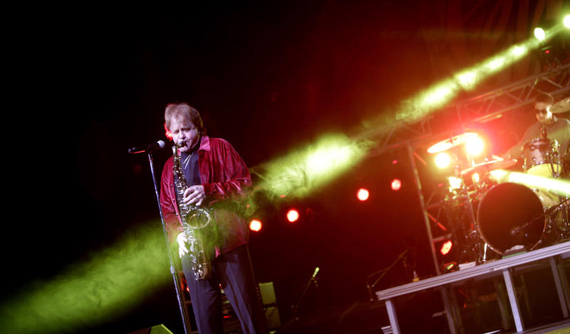 FILE - In this April 2, 2016 file photo, Eddie Money performs at GlenOak High School in Canton, Ohio.   Family members have said Eddie Money has died on Friday, Sept. 13, 2019. (Bob Rossiter/The Repository via AP)