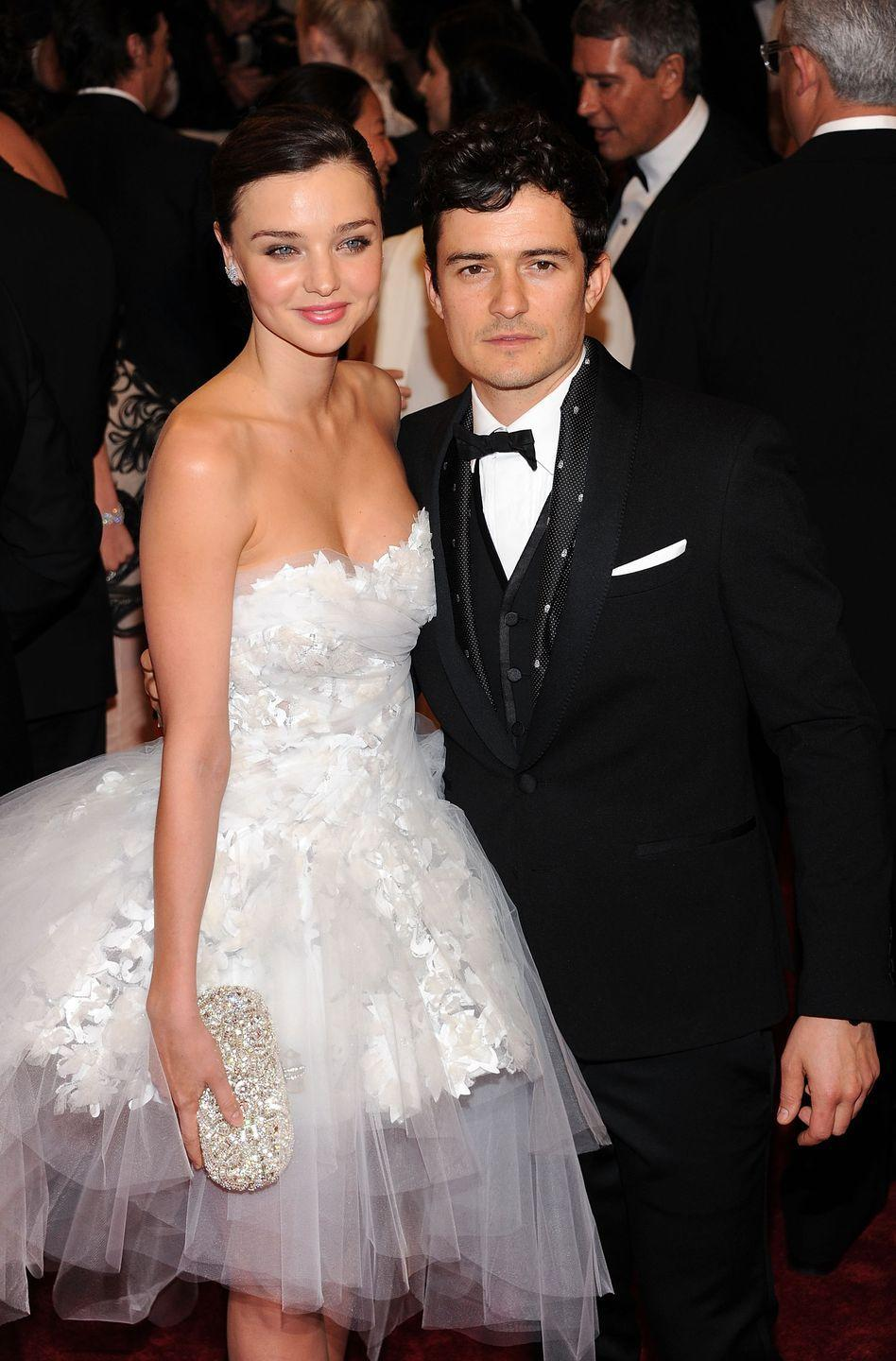 """<p>Fans of the celebrity couple were still celebrating their engagement news when reports of Orlando Bloom and Miranda Kerr's elopement circulated. The model was forced to make a statement in order to explain her last-minute cancellation from a David Jones department store event. """"David Jones very graciously released me during this period so we could celebrate an intimate ceremony and honeymoon together,"""" <a href=""""https://people.com/celebrity/orlando-bloom-and-miranda-kerr-secretly-marry/"""" rel=""""nofollow noopener"""" target=""""_blank"""" data-ylk=""""slk:Miranda said in a statement"""" class=""""link rapid-noclick-resp"""">Miranda said in a statement</a>.</p>"""
