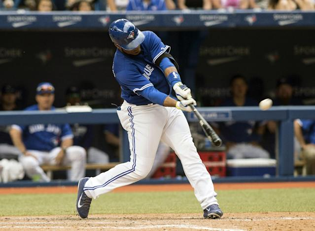 Toronto Blue Jays Edwin Encarnacion hits a walk-off three-run home run during the ninth inning of a baseball game, Wednesday, July 2, 2014 in Toronto. (AP Photo/The Canadian Press, Chris Young)