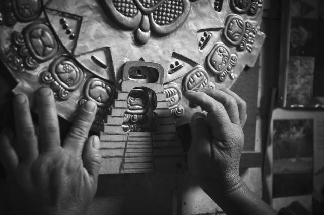 <p>Shaman Tata' Xuan uses the ritual Maya calendar in his practice. (Photograph by Fran Antmann) </p>