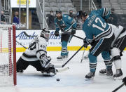 San Jose Sharks center Patrick Marleau (12) scores a goal past Los Angeles Kings goaltender Calvin Petersen (40) during the first period of an NHL hockey game Friday, April 9, 2021, in San Jose, Calif. (AP Photo/Tony Avelar)