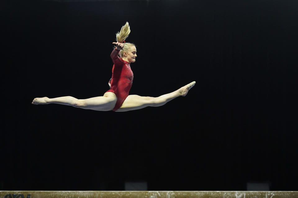 Riley McCusker performs on the balance beam during the Winter Cup gymnastics competition, Saturday, Feb. 27, 2021, in Indianapolis. (AP Photo/Darron Cummings)
