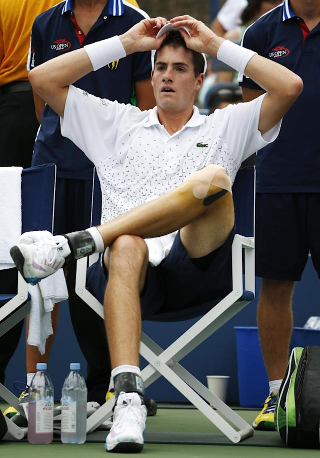 John Isner, of the United States, takes a break between games against Philipp Kohlschreiber, of Germany, during the third round of the 2014 U.S. Open tennis tournament, Saturday, Aug. 30, 2014, in New York. (AP Photo/Kathy Willens)