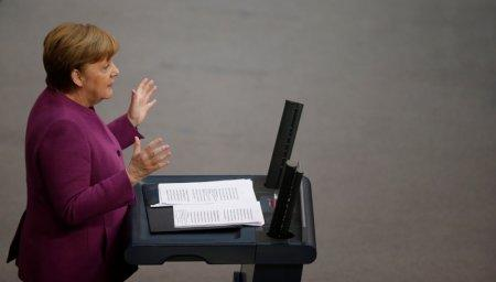 Chancellor Angela Merkel addresses the German lower house of parliament Bundestag in Berlin, Germany, February 22, 2018. REUTERS/Axel Schmidt