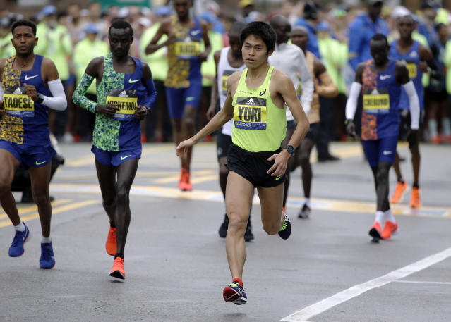 Yuki Kawauchi, of Japan, winner of the 2018 Boston Marathon, warms up before the start of the 123rd Boston Marathon on Monday, April 15, 2019, in Hopkinton, Mass. (AP Photo/Steven Senne)