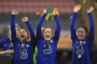 Chelsea's Sam Kerr, left, Erin Cuthbert and Melanie Leupolz, right, celebrate with the trophy after winning the FA Women's League Cup final soccer match against Bristol City at Vicarage Road, London, Sunday March 14, 2021. (Mike Egerton/PA via AP)