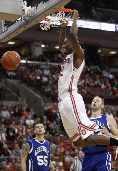 Ohio State's Sam Thompson, center, dunks the ball in front of UNC-Asheville's Trent Meyer, left, and D.J. Cunningham during the first half of an NCAA college basketball game in Columbus, Ohio, Saturday, Dec. 15, 2012. Ohio State won 90-72. (AP Photo/Paul Vernon)