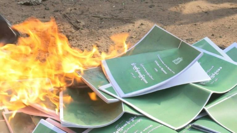 Yangon protesters burn copies of military-drafted 2008 constitution