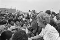 """Then-first lady Pat Nixon greets people at the dedication of Friendship Park in San Diego and Tinjana, Mexico on Aug. 18, 1971. In the days before Joe Biden became president, construction crews worked quickly to finish Donald Trump's wall at an iconic cross-border park overlooking the Pacific Ocean that then-first lady Pat Nixon inaugurated in 1971 as symbol of international friendship. Biden on Wednesday, Jan. 20, 2021 ordered a """"pause"""" on all wall construction within a week, one of 17 executive edicts issued on his first day in office, including six dealing with immigration. (Richard Nixon Presidential Library and Museum via AP)"""