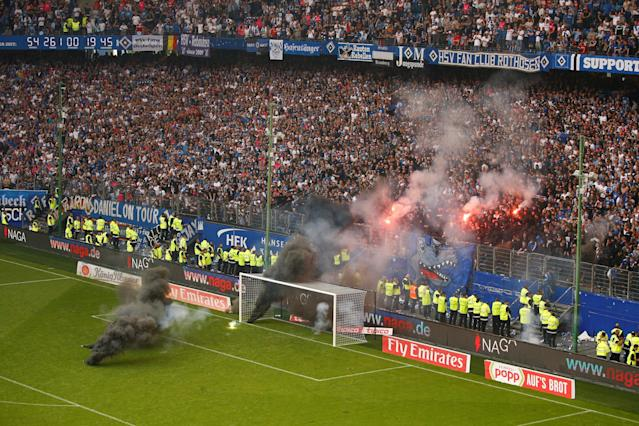 Soccer Football - Bundesliga - Hamburger SV v Borussia Moenchengladbach - Volksparkstadion, Hamburg, Germany - May 12, 2018 Hamburg fans let off flares and throw smoke bombs on to the pitch REUTERS/Morris Mac Matzen DFL RULES TO LIMIT THE ONLINE USAGE DURING MATCH TIME TO 15 PICTURES PER GAME. IMAGE SEQUENCES TO SIMULATE VIDEO IS NOT ALLOWED AT ANY TIME. FOR FURTHER QUERIES PLEASE CONTACT DFL DIRECTLY AT + 49 69 650050