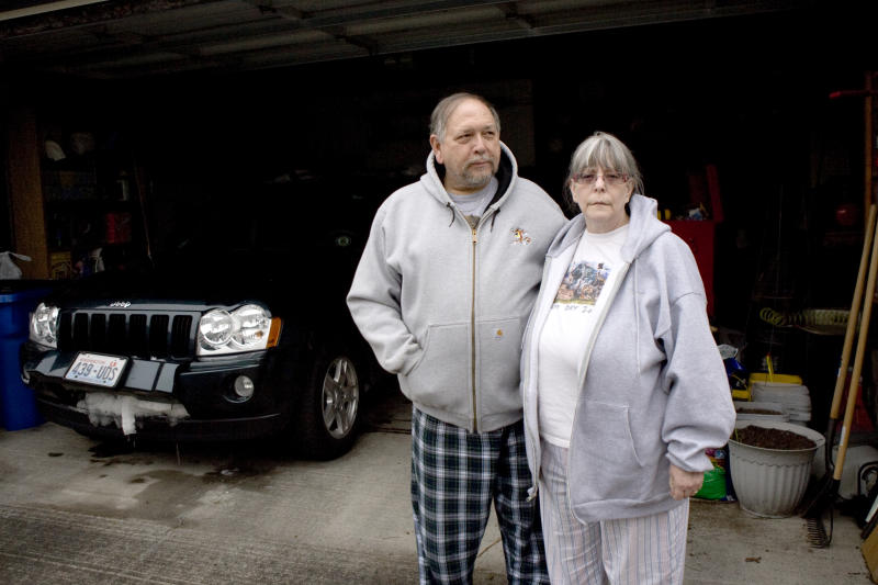 ** CORRECTS STATE FROM OREGON TO WASHINGTON **  John and Pat Norvell stand outside their home in Vancouver, Wash.  on Saturday, Feb. 16, 2011.  The couple were trapped for four days on a secluded, forest road near Mount St. Helens with only jelly beans to eat and snow for water.   Their ordeal, which began when the 63-year-olds' Jeep Grand Cherokee slid into a ditch, ended Friday when they were spotted by campers.  (AP Photo/The Oregonian, Ross William Hamilton)