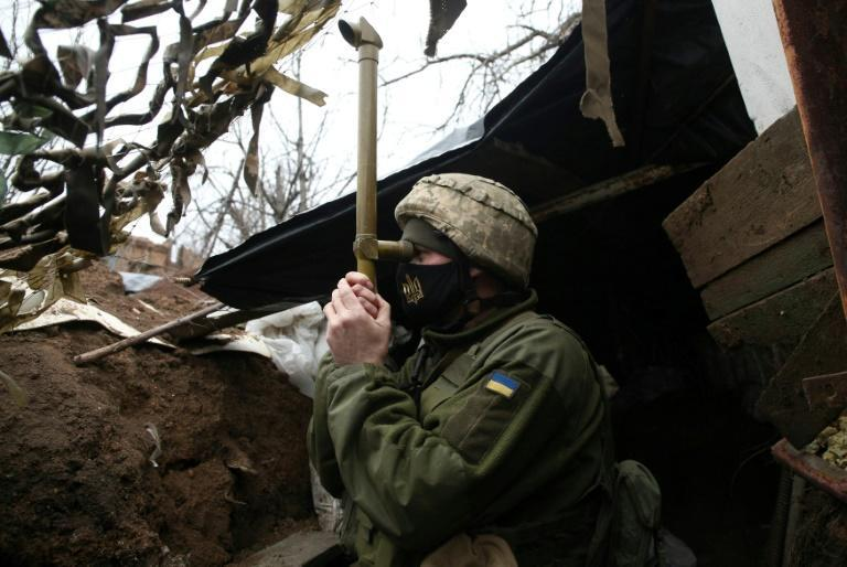 A Ukrainian serviceman stands guard at a position on the frontline with Russia-backed separatists near the small city of Marinka, Donetsk region, on April 12, 2021