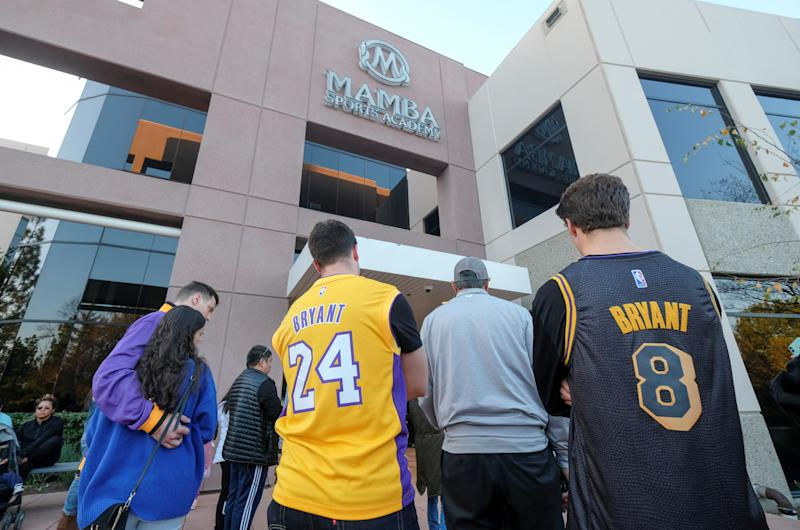 Fans gather at a makeshift memorial for former NBA player Kobe Bryant outside of the Mamba Sports Academy in Thousand Oaks, California, U.S., January 26, 2020. REUTERS/Ringo Chiu