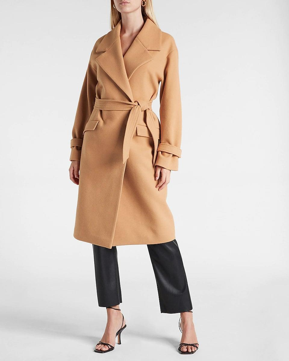 <p>This <span>Express Belted Wrap Front Felt Coat</span> ($228) looks so good even when styled as a top, we never thought about wearing it like this until now. </p>