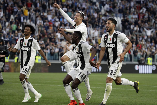 From left, Juventus' Juan Cuadrado, Cristiano Ronaldo, Blaise Matuidi and Emre Can celebrate at the end of a Serie A soccer match between Juventus and AC Fiorentina, at the Allianz stadium in Turin, Italy, Saturday, April 20, 2019. Juventus clinched a record-extending eighth successive Serie A title, with five matches to spare, after it defeated Fiorentina 2-1. (AP Photo/Luca Bruno)