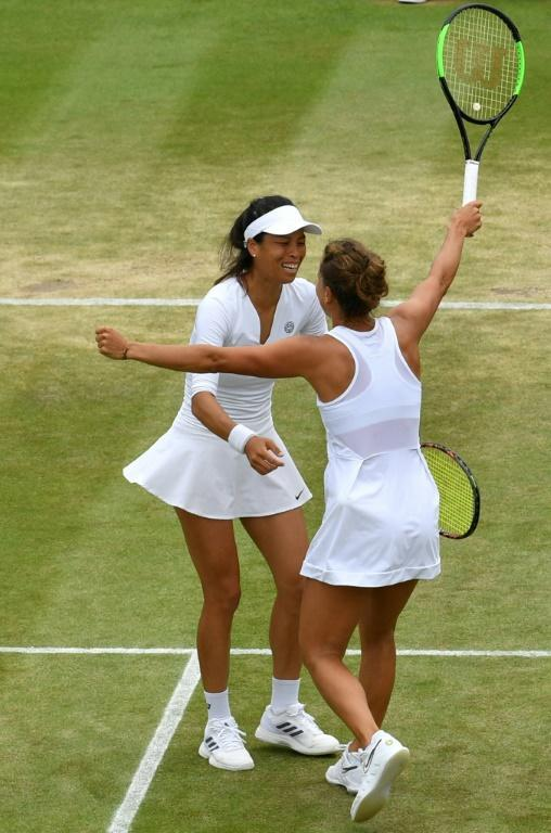 Hsieh Su-Wei and Barbora Strycova celebrate after their doubles quarter-final victory (AFP Photo/GLYN KIRK)
