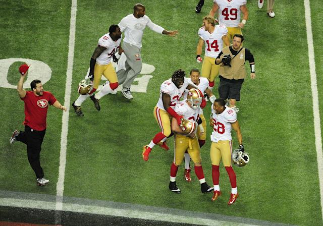 The San Francisco 49ers celebrate after winning the NFC championship in Atlanta on January 20, 2013. (Photo by Scott Cunningham/Getty Images)