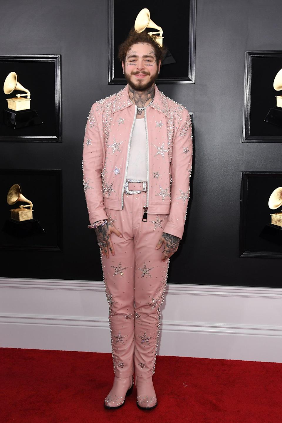 <p>Wearing a pink embellished suit.</p>