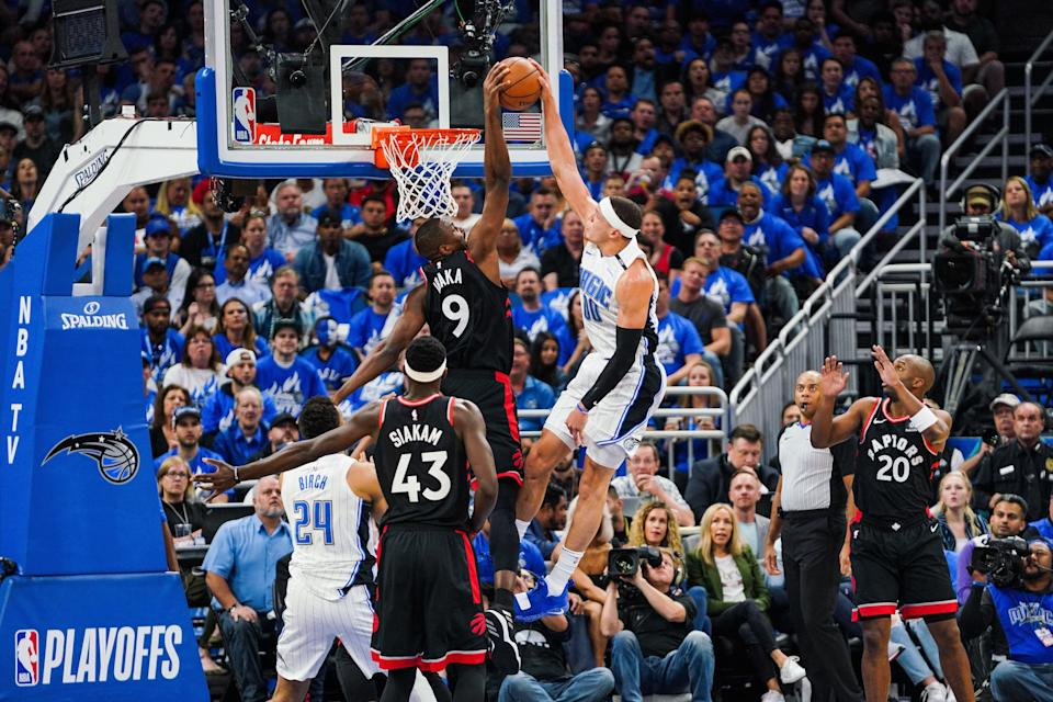 ORLANDO, FLORIDA - APRIL 21: Serge Ibaka #9 of the Toronto Raptors blocks a dunk from Aaron Gordon #00 of the Orlando Magic at Amway Center on April 21, 2019 in Orlando, Florida. (Photo by Cassy Athena/Getty Images)