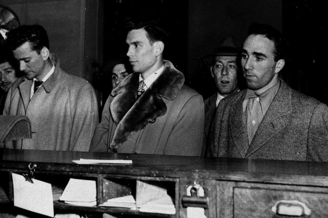 FILE - In this March 27, 1951, file photo, three City College of New York basketball players, from left, Norman Mager, Irwin Dambrot and Herb Cohen are booked at New York's Elizabeth Street police station in connection with fixing of three basketball games at Madison Square Garden in 1949 and 1950. Mager and Dambrot last played during 1949-50 season and Cohen was a member of the 1950-51 CCNY squad. They were kings of the town one day, and the next day they were the bums of the town, really, because of the scandal, said Dambrots nephew, Duquesne coach Keith Dambrot. (AP Photo/File)