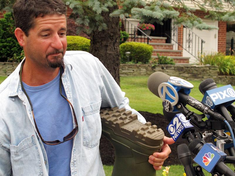 John Aldridge describes Thursday, July 25, 2013, in Oakdale, N.Y., how he was rescued by the U.S. Coast Guard off the coast of Montauk, N.Y., a day earlier after falling off a lobster fishing boat. Aldridge spent about 12 hours in the water clinging to a pair of rubber boots to keep him afloat. (AP Photo/Frank Eltman)