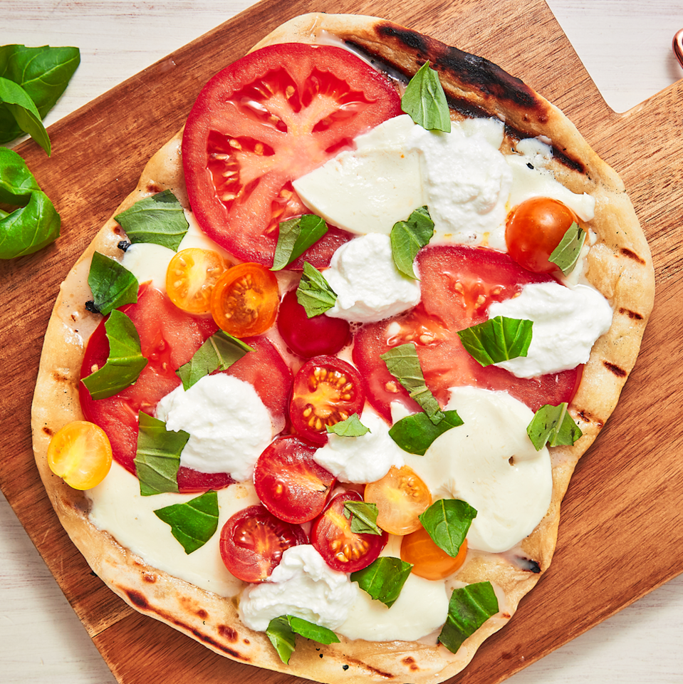 """<p>Summer is meant to be enjoyed outdoors and away from the oven. If you've never tried grilling pizza, now is the time to start. It is far easier than you can imagine, and there's no pizza stone required! For this simple grilled pizza recipe, we are placing the dough directly on the grill.</p><p>Get the <a href=""""https://www.delish.com/uk/cooking/recipes/a34697522/grilled-pizza-recipe/"""" rel=""""nofollow noopener"""" target=""""_blank"""" data-ylk=""""slk:Grilled Pizza"""" class=""""link rapid-noclick-resp"""">Grilled Pizza</a> recipe.</p>"""