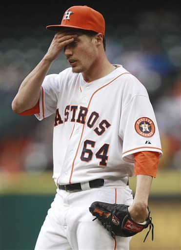 Houston Astros starting pitcher Lucas Harrell pauses after giving up a home run to Detroit Tigers' Miguel Cabrera during the second inning of a baseball game, Saturday, May 4, 2013, in Houston. (AP Photo/Patric Schneider)