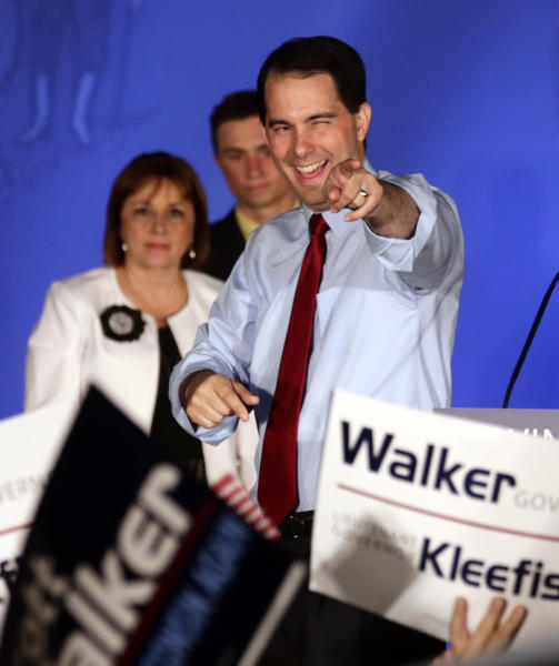 Wisconsin Republican Gov. Scott Walker reacts at his victory party Tuesday, June 5, 2012, in Waukesha, Wis. Walker defeated Democratic Milwaukee Mayor Tom Barrett on Tuesday for the second time in year and a half, turning back a recall effort that began with the collection of more than 900,000 signatures seeking his ouster. (AP Photo/Morry Gash)