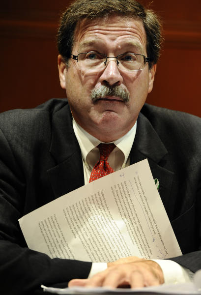 Bill Sherlach, husband of Sandy Hook Elementary School shooting victim Mary Sherlach, holds a statement he wrote as he speaks before the The Task Force on Victim Privacy and the Public's Right to Know, Wednesday, Oct. 30, 2013, in Hartford, Conn. Sherlach and Nicole Hockley, mother of victim Dylan Hockley, told the panel they don't want the 911 tapes from that day released to the public. The Freedom of Information Commission has ordered the release of the 911 recordings, but a prosecutor has said the ruling will be appealed. (AP Photo/Jessica Hill)