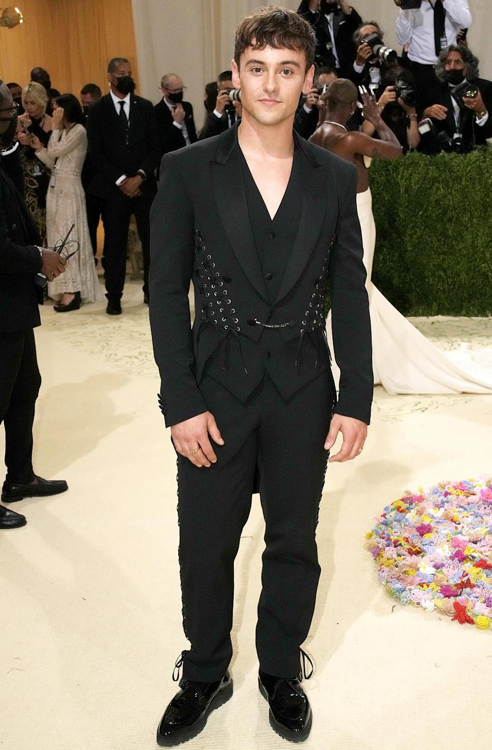 <p>Olympian Daley ditched his impressive knit sweaters for a laced-up Moschino suit.</p>