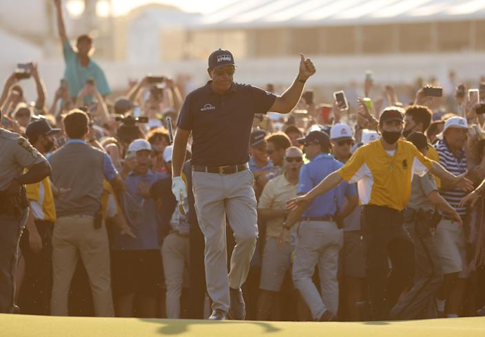 Phil Mickelson of the United States gives a thumbs up as he walks to the 18th green during the final round of the 2021 PGA Championship held at the Ocean Course of Kiawah Island Golf Resort on May 23, 2021 in Kiawah Island, South Carolina. / Credit: Jamie Squire / Getty Images
