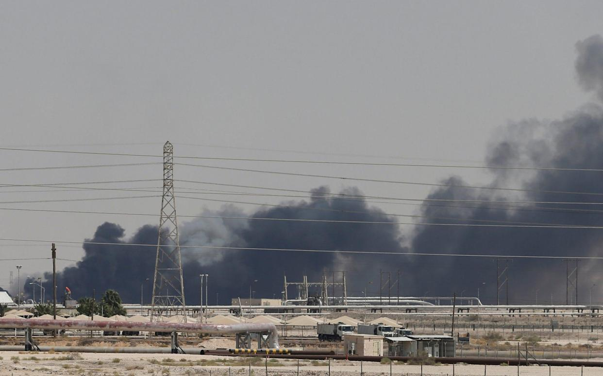 Smoke is seen following a fire at Aramco facility in the eastern city of Abqaiq - REUTERS