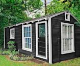 """<p>Dallas designer Paige Morse renovated two 100-year-old sheds in her backyard to create a cozy home away from home. With just two rooms and 250 square feet, her space is remarkably stylish and space-efficient.</p><p><a class=""""link rapid-noclick-resp"""" href=""""https://www.amazon.com/Tiny-House-Live-Small-Dream/dp/0525576614?tag=syn-yahoo-20&ascsubtag=%5Bartid%7C10050.g.1887%5Bsrc%7Cyahoo-us"""" rel=""""nofollow noopener"""" target=""""_blank"""" data-ylk=""""slk:SHOP TINY HOUSE COFFEE TABLE BOOKS"""">SHOP TINY HOUSE COFFEE TABLE BOOKS</a></p>"""