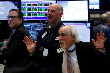 Traders joke around on the floor of the NYSE