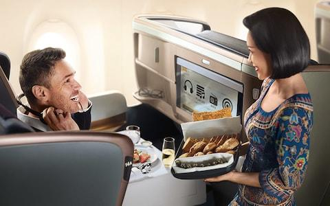 On board Singapore Airlines - Credit: CHRISSISARICH